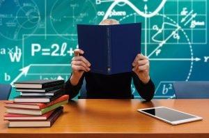 Man studies formulas at a work desk.